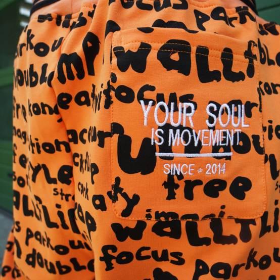 Tepláky pro parkour Soul Keywords Oranžové